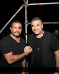 18 صورة من حفل عمرو دياب في اليونان بصيف 2018 .. دينا الشربيني مرة آخرى