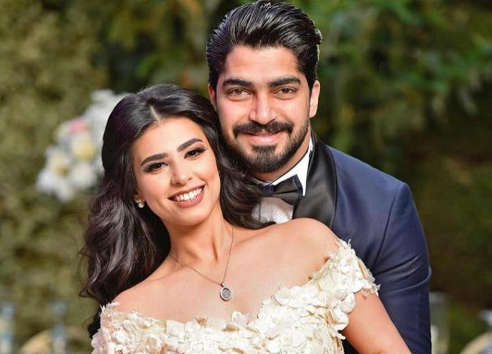 مينا عطا وزوجته