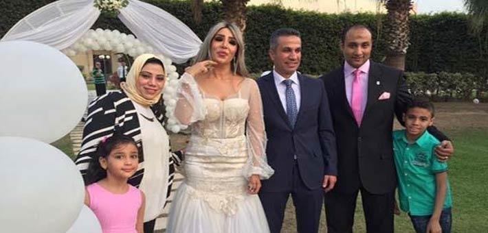 إيمان أبوطالب والعميد محمد سمير من حفل الزفاف
