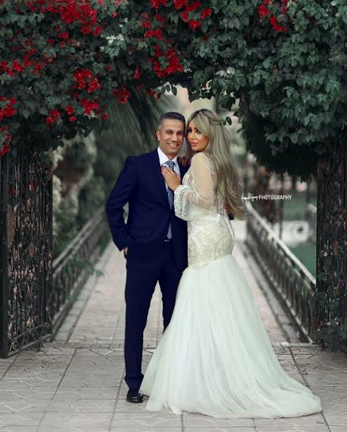 إيمان أبو طالب مع زوجها المتحدث العسكري السابق محمد سمير
