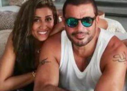 """بالفيديو- عمرو دياب مع دينا الشربيني على المسرح ويفاجيء جمهوره:  إنها """"برج الحوت"""""""