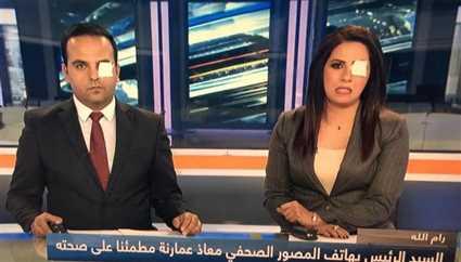 مذيعان فلسطينيان بعين واحدة على الشاشة تضامنا مع المصور معاذ