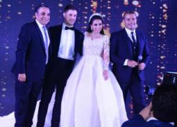 """عمرو دياب ورامي عياش يشعلان زفاف """"نورهان"""" و""""وليد"""" بحضور نجوم الفن والمشاهير"""