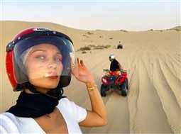 بالصور والفيديو- ذا ويكند وحبيبته بيلا حديد يوثقان مغامراتهما في أبو ظبي