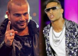 """بالفيديو- صراع على صفيح ساخن بين عمرو دياب بـ""""مقدرش عالنسيان"""" ومحمد رمضان بأغنيته """"القمر"""""""