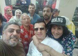 بالصور- إيهاب توفيق ومحمد محيي وهاني شنودة وعلي حميدة يساندون حسام حسني في الماجستير