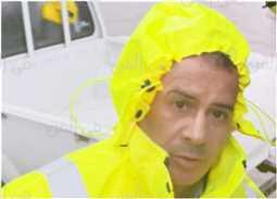 صورة: جابر القرموطي وسط الأمطار