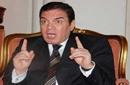 """بالفيديو: """"الجزيرة"""" تقطع بث مؤتمر مدير مكتب عمر سليمان عقب وصف قطر بـ""""عقلة الأصبع"""""""
