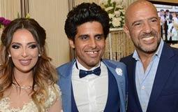 حمدي الميرغني وإسراء عبد الفتاح يحتفلان بعيد ميلاد أشرف عبد الباقي في حفل زفافهما