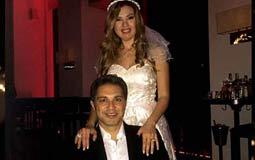 رانيا فريد شوقي ارتدت فستان أبيض بسيط أثناء الاحتفال بزواجها من تامر الصراف