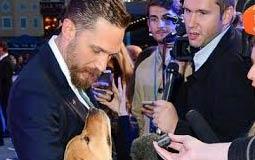 بالصور والفيديو- توم هاردي يصطحب كلبه في افتتاح فيلمه Legend