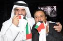 فؤاد يقبل العلم الإماراتي والجسمي يقبل العلم المصري