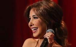 نانسي عجرم توعد عمرو أديب بالغناء لنادي الزمالك