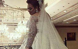 دينا محسن تستعرض فستان زفافها